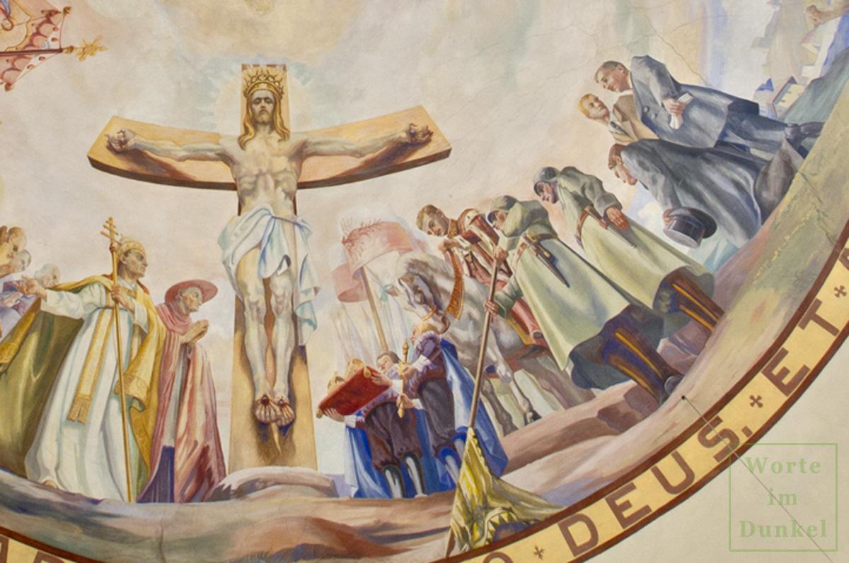 Der Ausschnitt aus dem Fresko zeigt den gekreuzigten Jesus Christus mit einer goldenen Krone. Neben ihm stehen Kaiser Karl I. zu Pferde, Soldaten, Dollfuß, Fey und Starhemberg